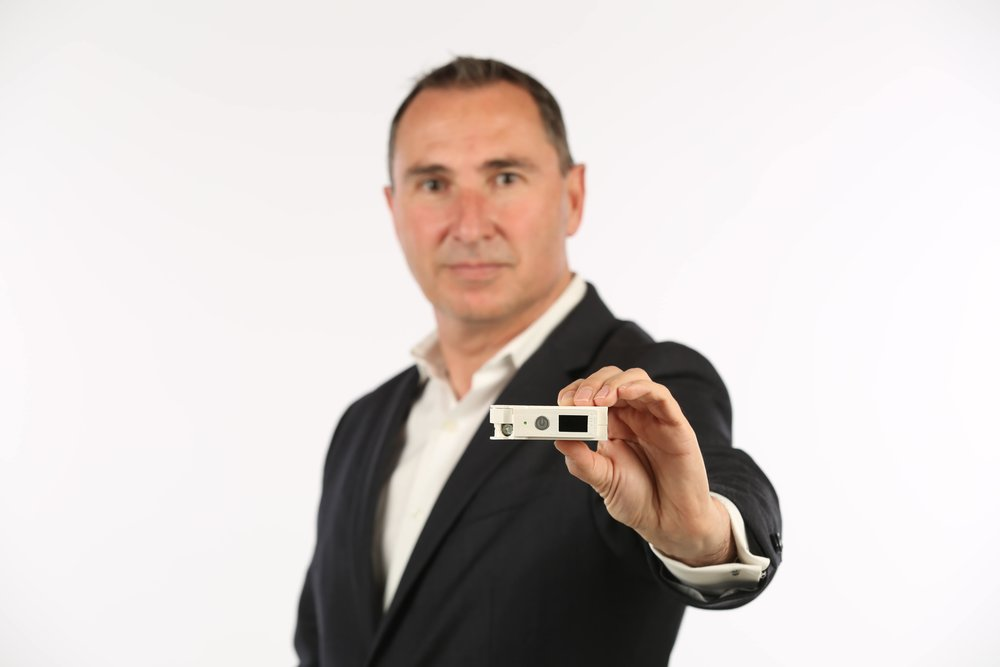 Thar Casey, CEO Amber Solutions with Amber's Premium Solid-State Smart Circuit Breaker.jpg