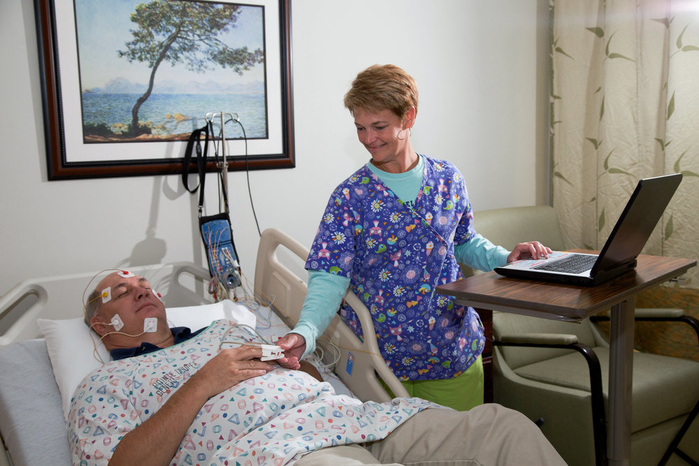 Sleep disorder nurse attends to patient.