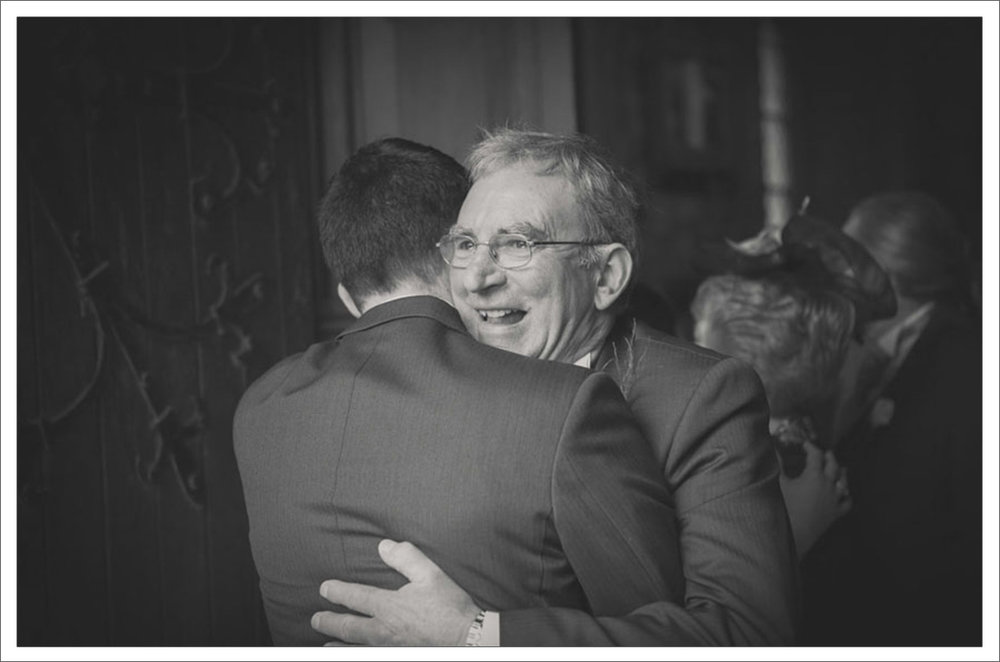 24-Father-and-son-embrace-on-wedding-day-Adare-Limerick-photography1.jpg