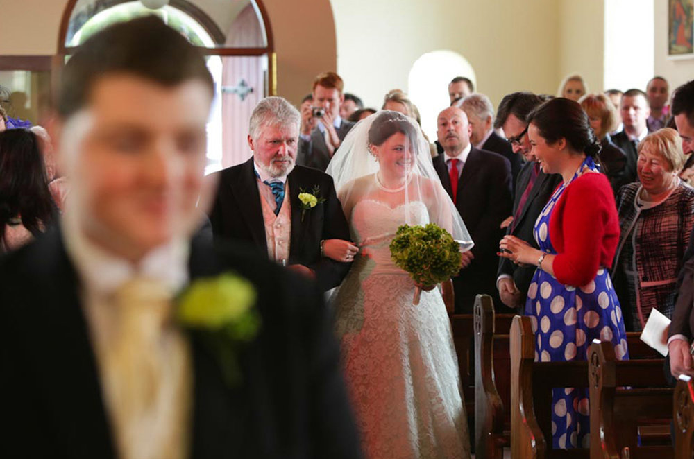 14_bride_walking_up_aisle_Killaloe_wedding.jpg