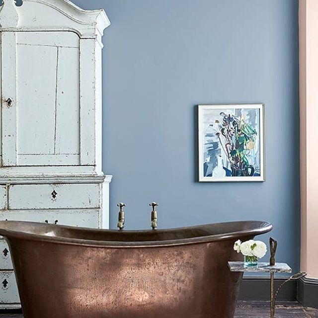 "We recently sourced this amazing tub for a design client, but having just seen it paired with this beautiful ""Grey Stone"" paint color, we're even more in love! . Would you choose a copper soaking tub?"