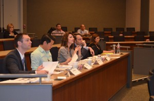 Ryan Baty of THE mattress HUB; Tien Huynh of Huynh Investments; Martha Piland of MB Piland Advertising & Marketing; and Matt Michaelis of Emprise Bank serve as business plan judges at the Youth Entrepreneur Final Flyers in Wichita on Thursday.