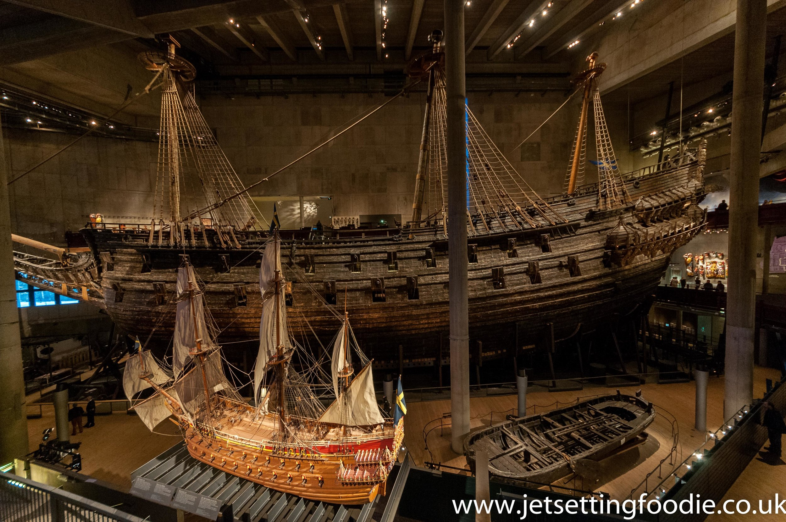 The Vasa in all its glory, fronted by a scale replica and its lifeboat.