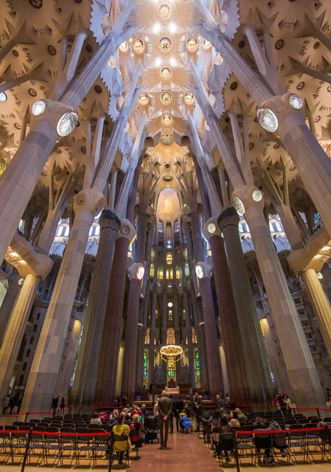 La Sagrada Familia: Stone columns branch out like trees to support the ceiling