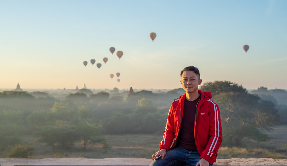 Bagan: Matthew Seow portrait with hot air balloons in the background