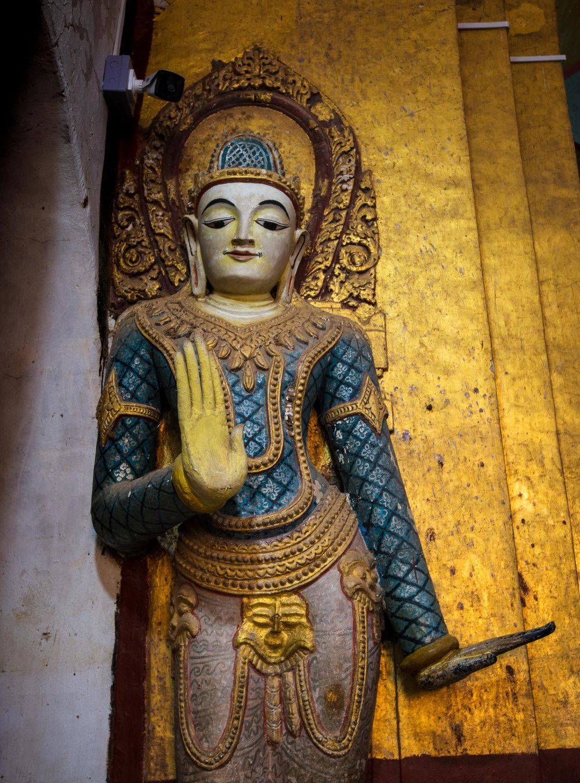 Colourfully painted smaller standing Buddha at Ananda Phaya Temple in Bagan