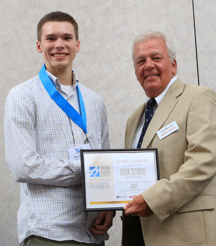Brian Sizemore, left, of New Covenant School, with Steve Mullins, Editor in Chief of the Independent Mail, during the 2015 STAR Student award event, May 18 in the Civic Center of Anderson.