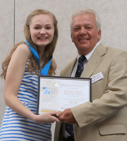 Rebekah Graves, English, New Covenant School, with Steve Mullins, Editor in Chief of the Independent Mail, during the 2015 STAR Student award event, May 18 in the Civic Center of Anderson.