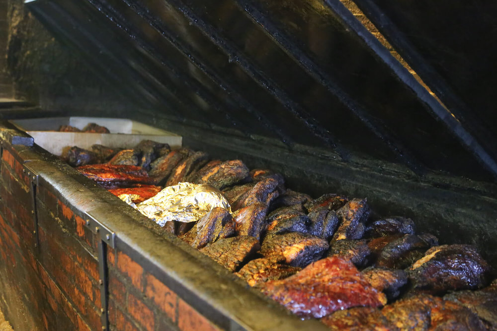Countless briskets cooking in Lockhart