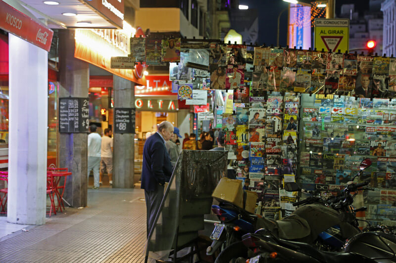 A man buying newspapers in Buenos Aires