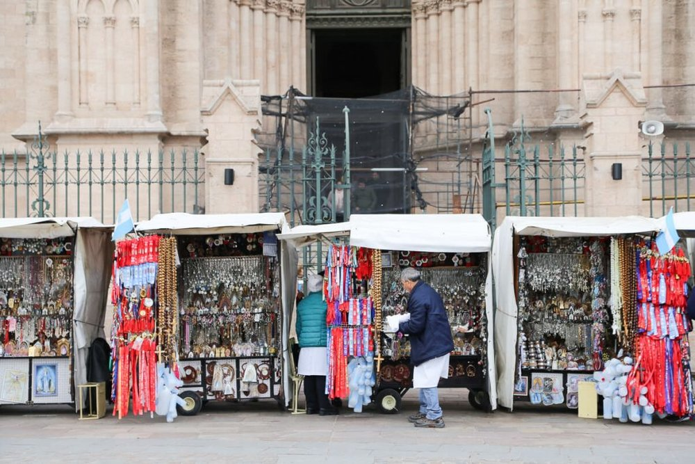 religious trinkets for sale outside the baslica in Lujan Argentina