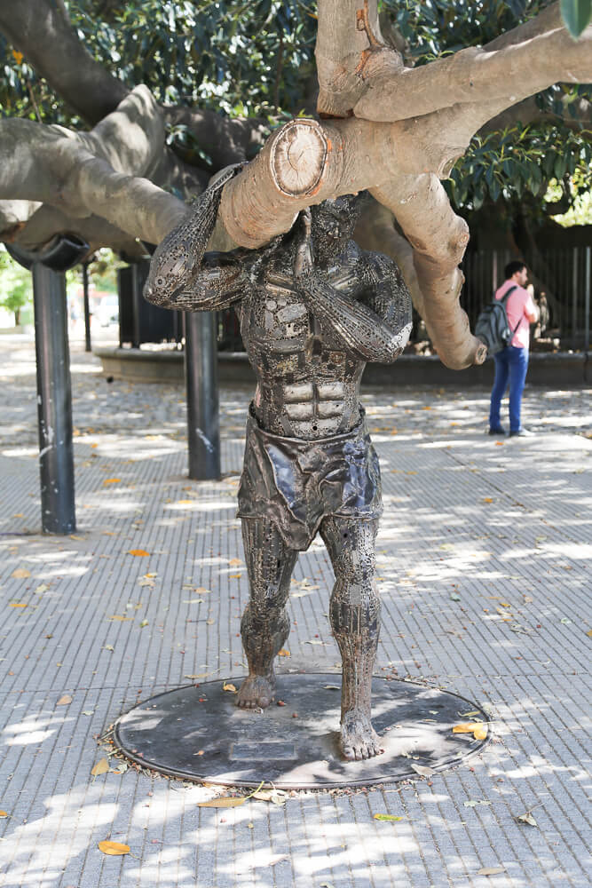 Statue of Atlas supports the oldest tree in Buenos Aires