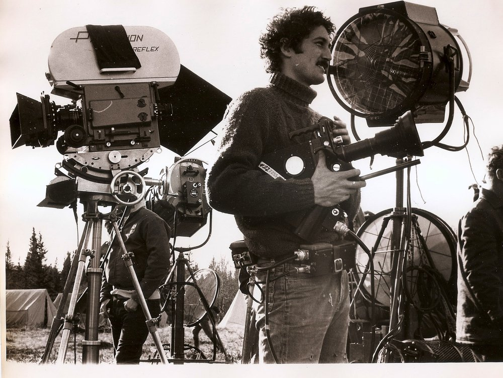 On the set of BIG MAN while filming doc THEMES AND VARIANTS. Although we were just a little 16mm doc film our technology was more advanced than theirs. We had radio mikes, an electric slate, hand held camera, and fast film.