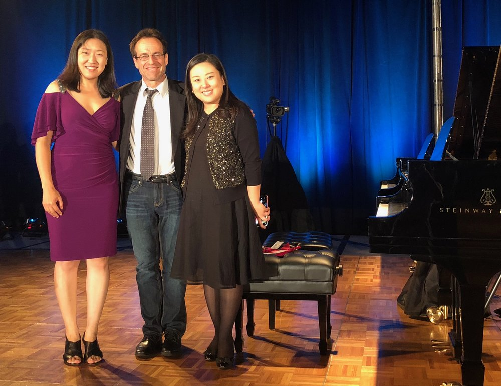 Minji Noh and Kookhee Hong with Stark after a performance of  Variation No. 4  for four-hands piano
