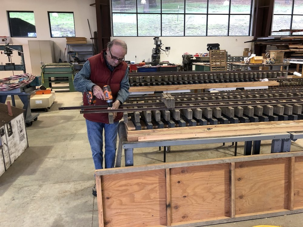 Gill taking apart old track panels to salvage rail