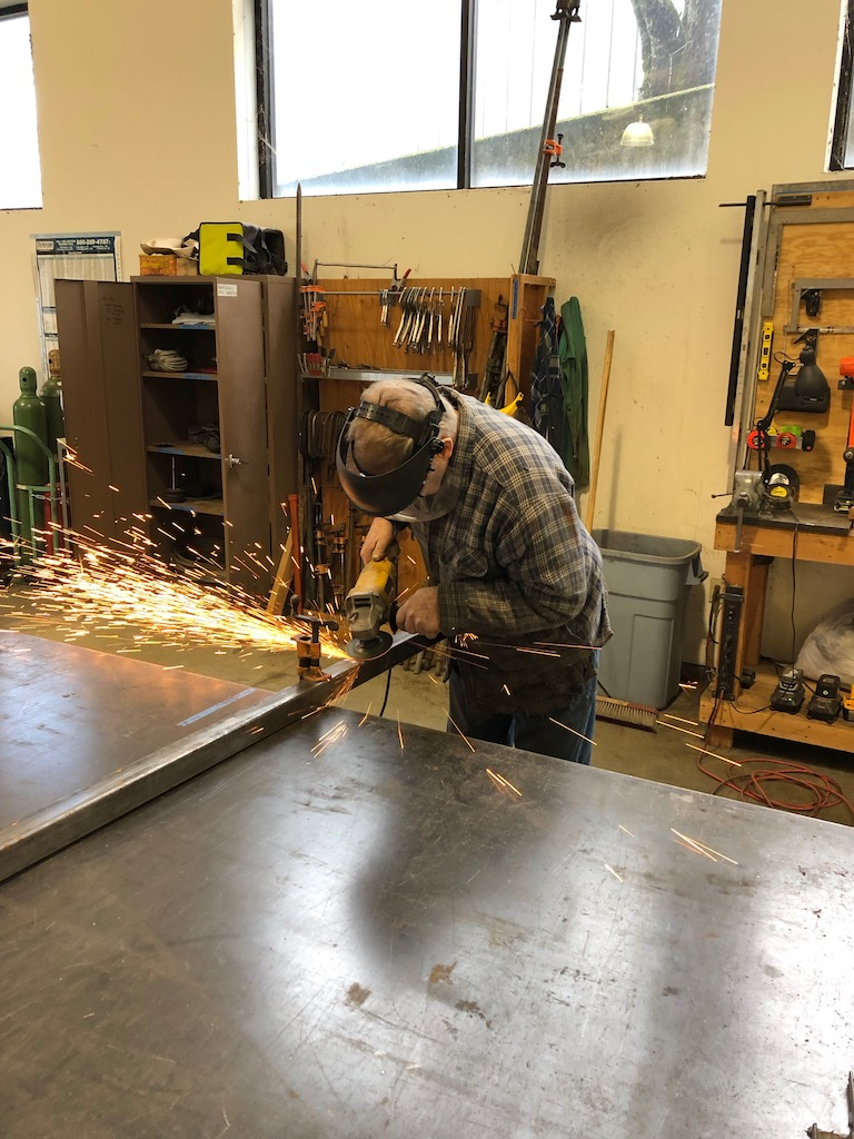 Tom taking apart tunnel panel jig to salvage the steel for the new bridge