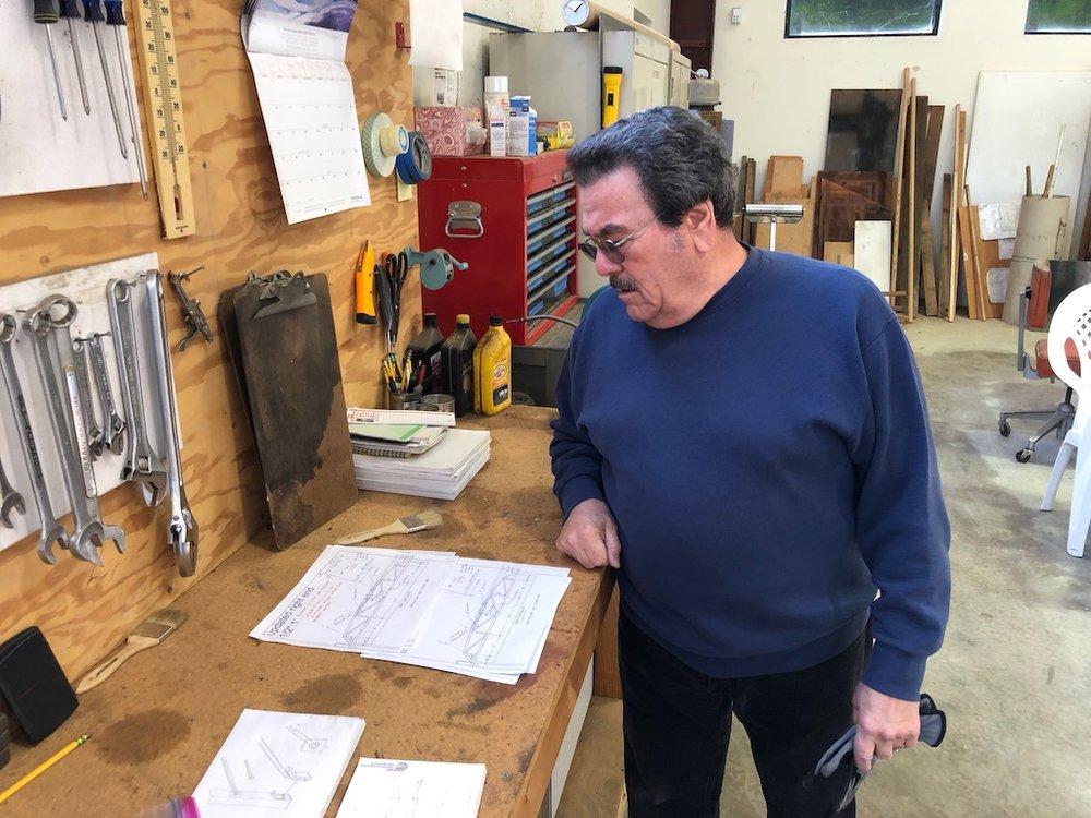 Carl triple checks bridge plans before cutting any steel