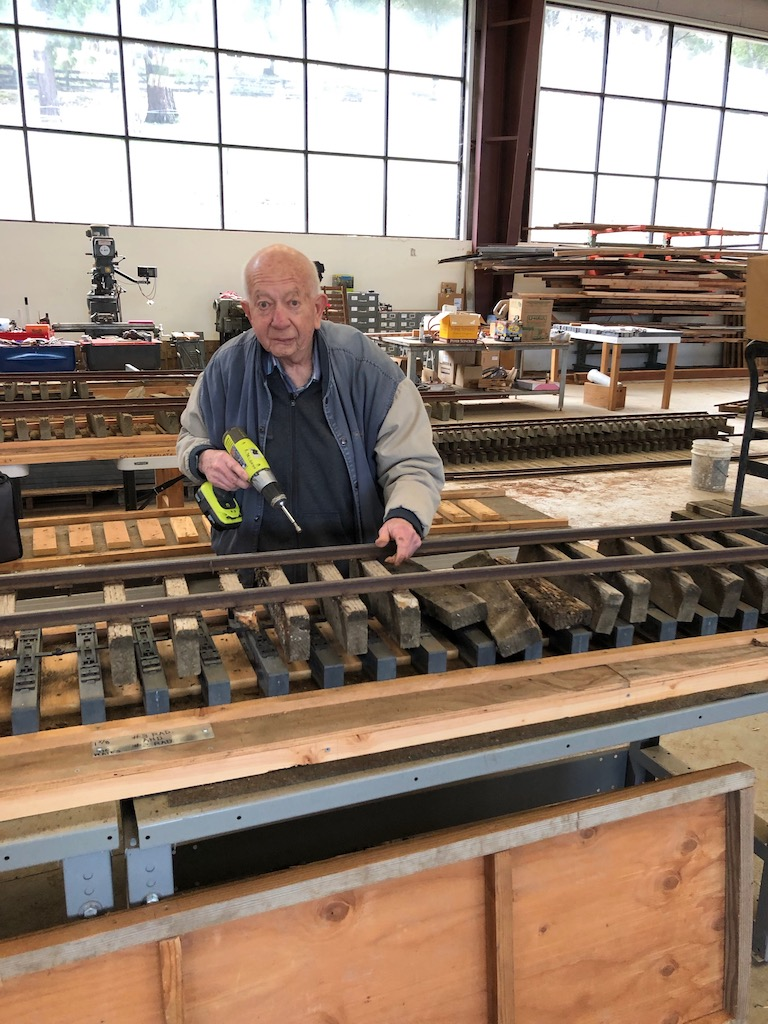 Renee continue the process of taking apart old track panels to salvage rail