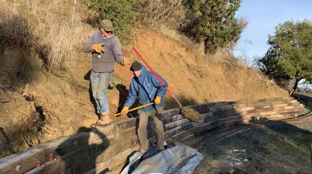 Whoops! Bruce and Bill preparing Rabbit Flat for the next rainstorm/mudslide.