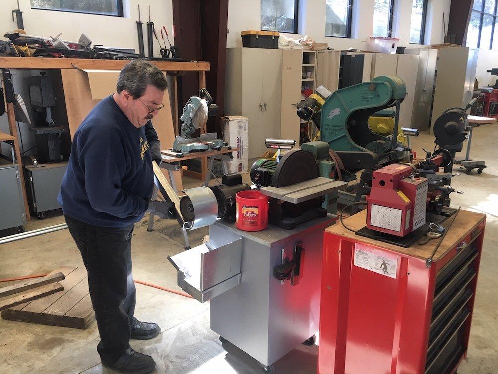 Carl deburring steel before welding