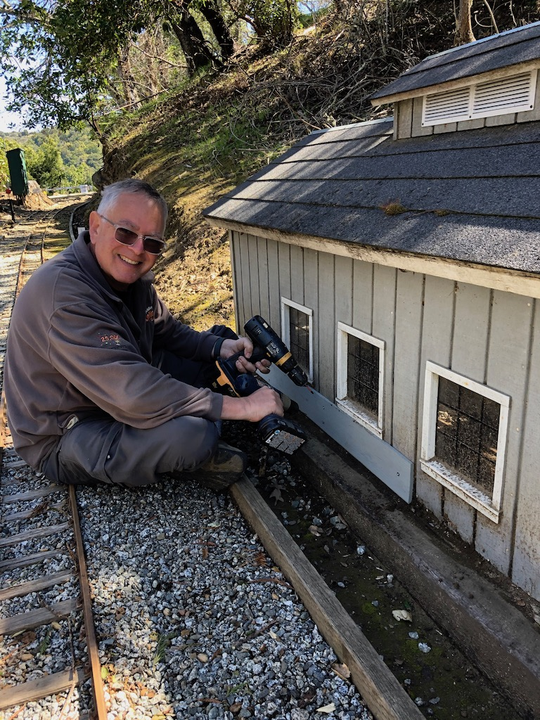 Russ patches the gritty gravel barn to keep rodents out