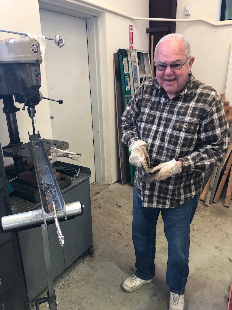 Jerry cutting bridge floor joists