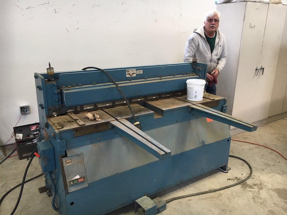 Randy cleans the shear to prepare it for its upcoming bridge work