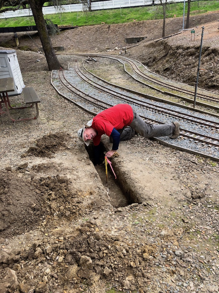 Bruce inspects the first grade beam foundation hole for the Lumber Camp Bridge