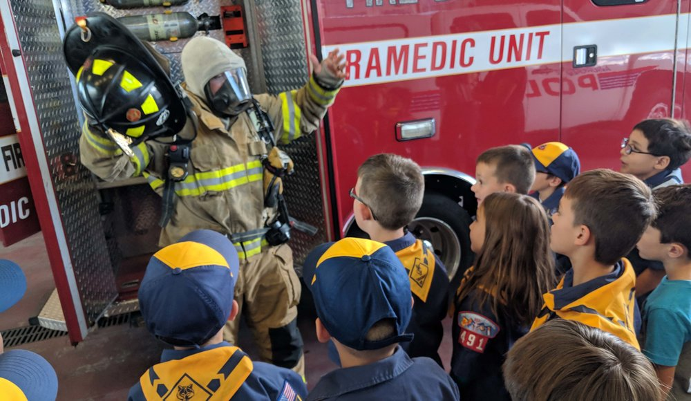 Community Engagement - Here scouts visit their local fire department, learning everything there is to know about how our Firefighters help keep us safe.