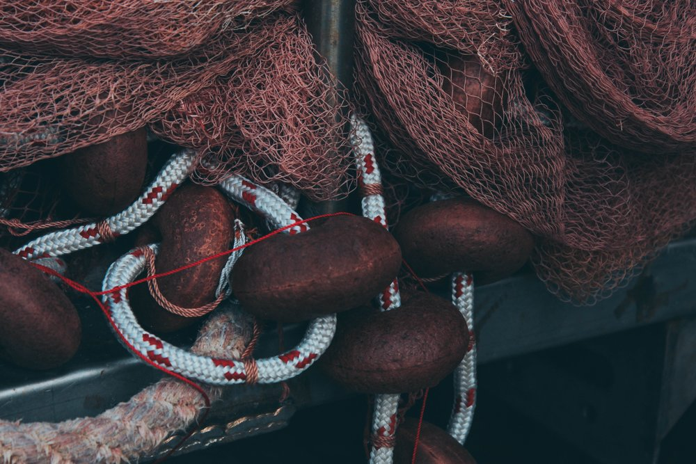 Pile of red fishing nets and ropes.