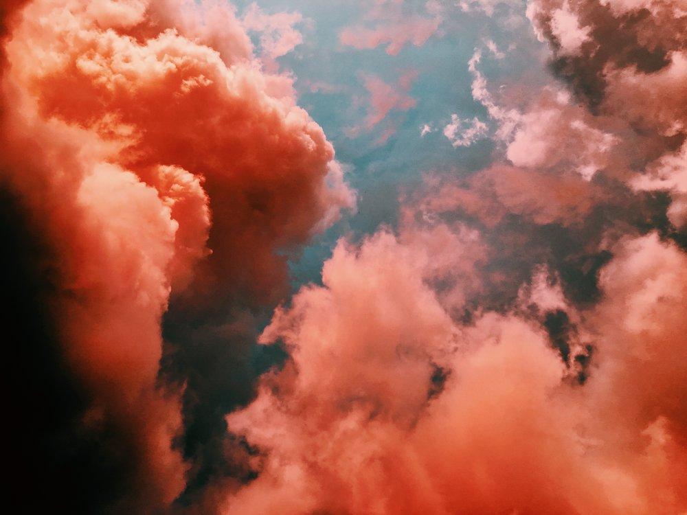 Blue sky full of dark pink clouds.