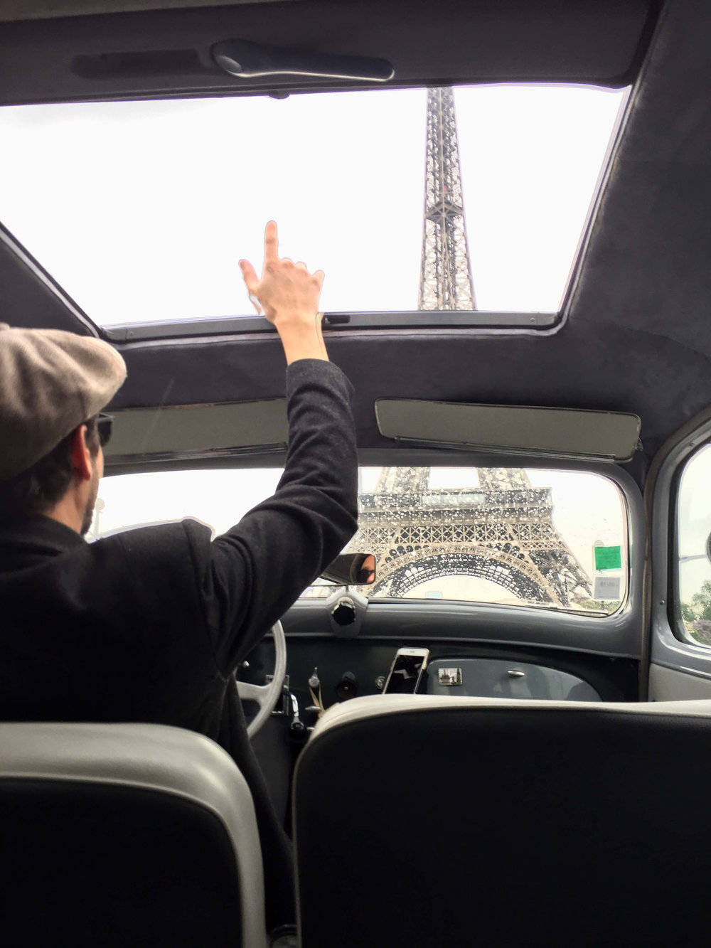City Wheels Paris - Eiffel Tower out The Sunroof of the vintage citroen traction avant