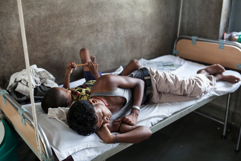 Ranjit rests with his older brother after receiving the treatment.