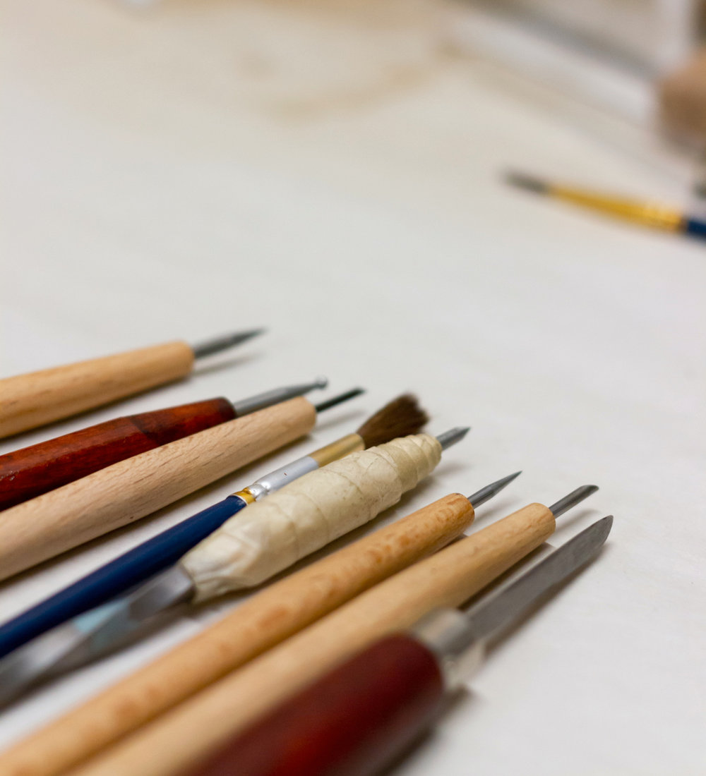 An assortment of tools used to mark, correct and create a copperplate.
