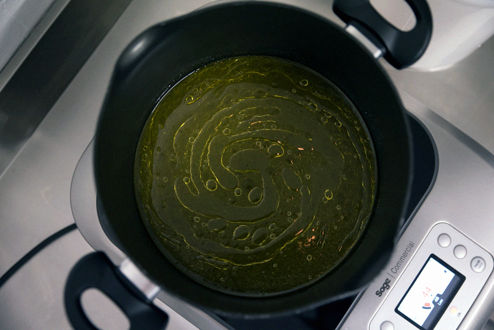 Mixing Ghee with Crazy Gin on Sage Induction Hob
