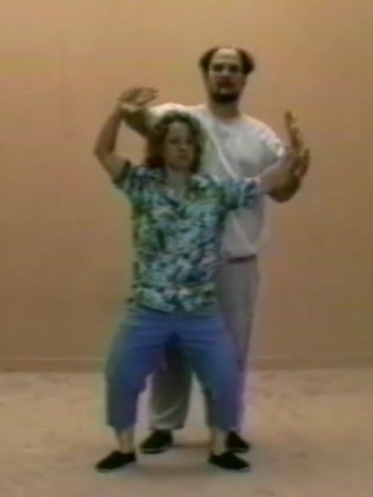 Mary Christianson with Master Bruce Frantzis. Still image from Wu Style Tai Chi Short Form instructional video, 1989.