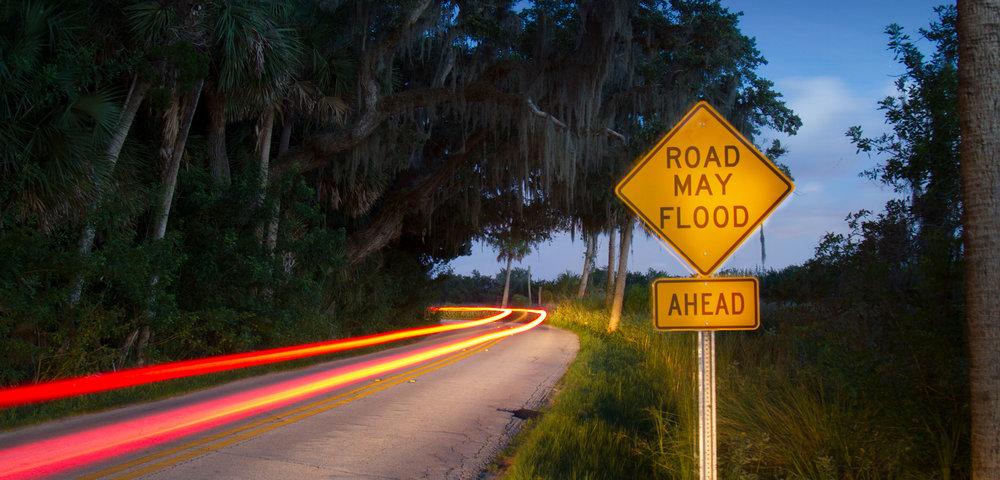 The bend on High Bridge Road along Bulow Creek in Ormond Beach, Florida at sunset.