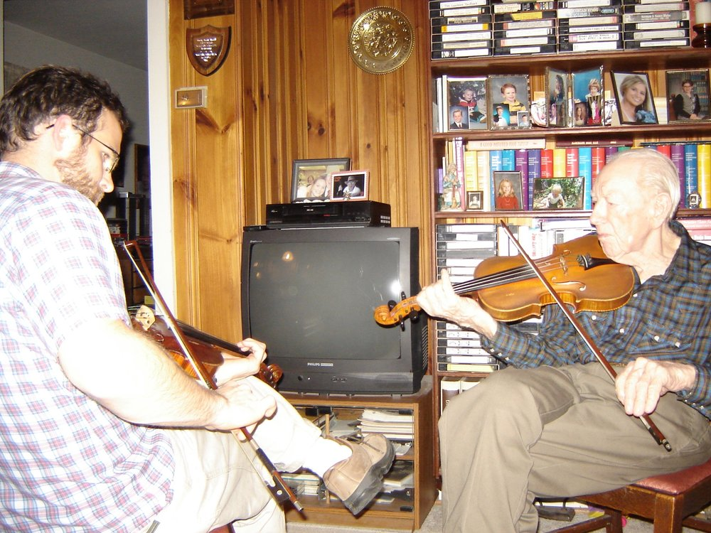Charlie Acuff and Joseph Decosimo in Alcoa, Tennessee mid-2000s. Charlie played fiddles made by his father. He was a gracious person and eager to make music. I first visited him when I was 16. I spent most of the visit trying to get my banjo in tune, and he patiently wiated