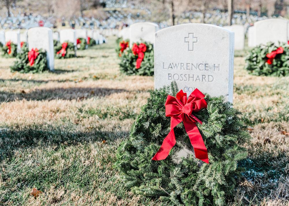 Christmas wreaths laid on the headstones at Arlington National Cemetery.