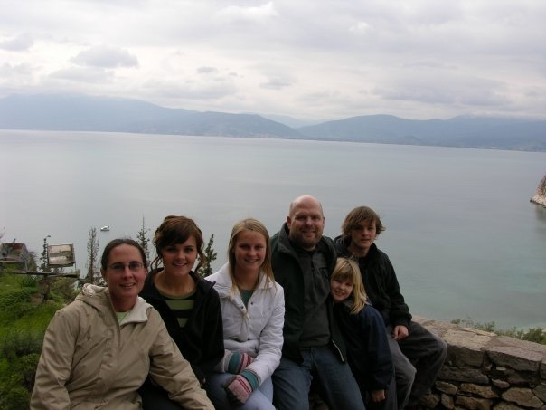 Helen, a former trailing child, and her family in Greece.