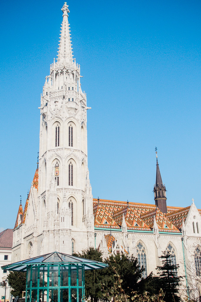 Amazing blue sky and colorful tiled roof of Matthias Church in Budapest.