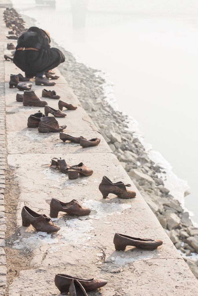 Metal shoe replicas along the frozen banks of the Danube River in Budapest. Memorial to Jews who were murdered here during World War II.