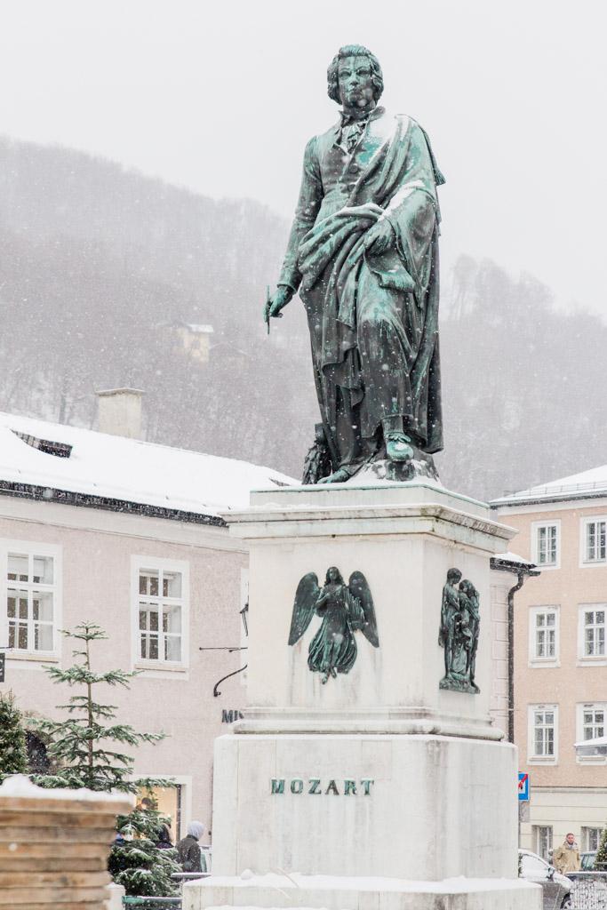 Snow-covered Mozart statue in Mozartplatz in  Salzburg, Austria.