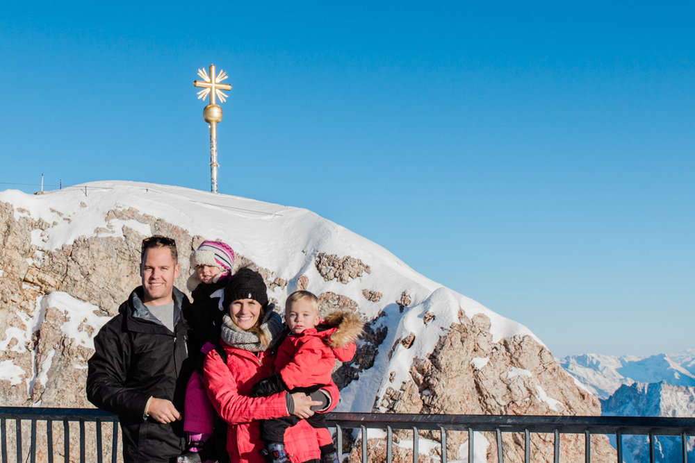 Family picture at the Zugspitze, the highest peak in Germany, in winter.