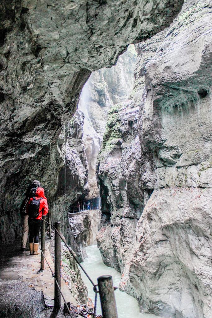 Hiking through the rocky Partnach Gorge in Garmisch, Germany.