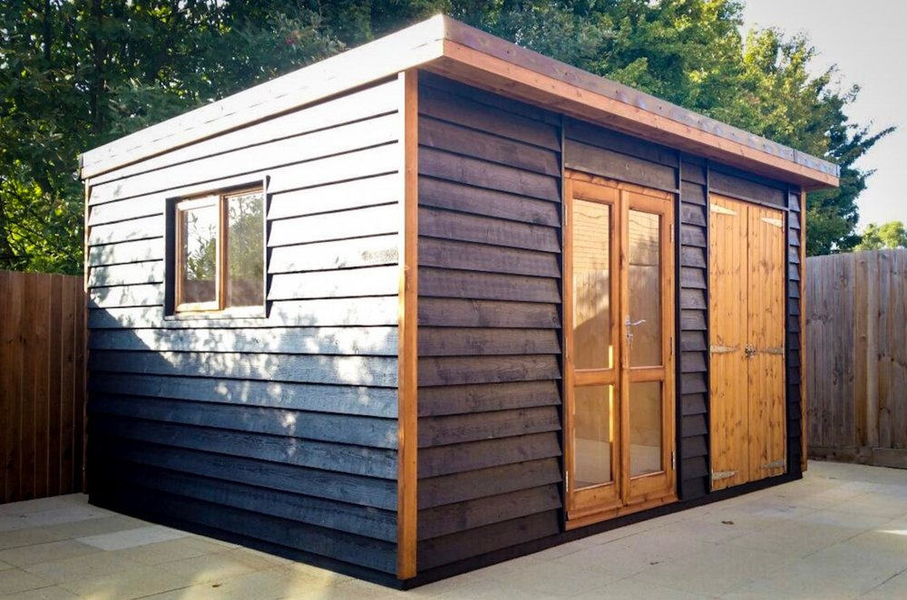 4.2M x 2.4M Garden Studio with built on Garden Store with joinery windows and doors, black barn style feather edge cladding and EPDM roof.JPG