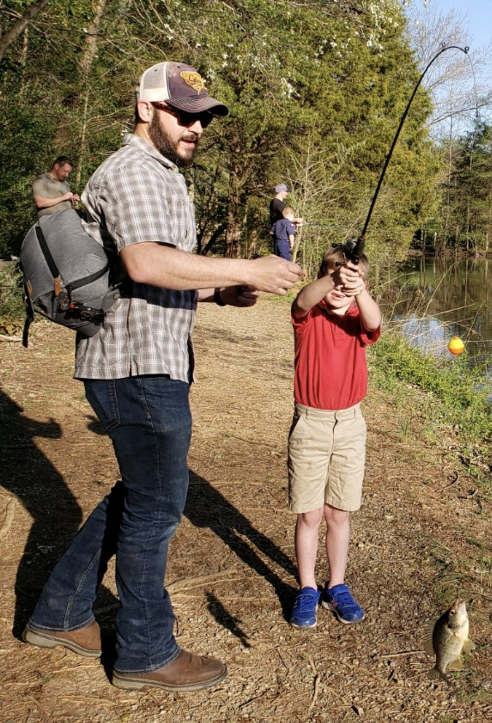 Me and Owen with one of his five fish (pic courtesy of Scott Vines)