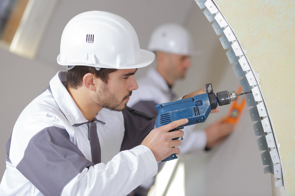 construction-worker-with-tools-and-drill-PCG9Z3Z.jpg