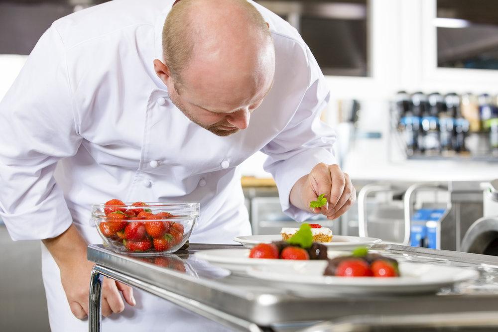 chef-decorates-dessert-cake-with-strawberry-in-PYKJPUE.jpg