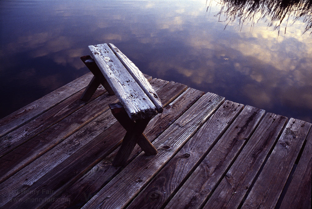 Decrepit bench on dock in old rice fields